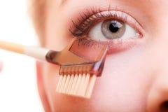 Closeup part of woman face eye makeup detail. Stock Image