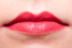 Closeup part of woman face red lips makeup detail. Stock Image