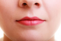 Closeup part of woman face red lips makeup detail. Royalty Free Stock Image