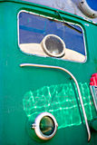 Closeup partial view of an old locomotive. The headlight of the Stock Images
