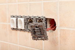 Closeup of a partially installed electrical wall socket Stock Photos