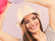 Closeup of partying girl. Young woman holding balloons. Celebration entertainment concept Royalty Free Stock Photo