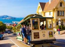 Closeup Passengers Riding SF Cable Car Alcatraz Stock Photo