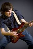 Closeup of a passionate guitaris playing Royalty Free Stock Photos