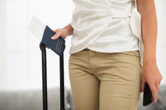 Closeup on passport, air ticket  in female hand Royalty Free Stock Photo