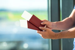 Closeup passports and boarding pass at airport Royalty Free Stock Images