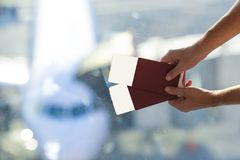 Closeup passports and boarding pass at airport Stock Photo