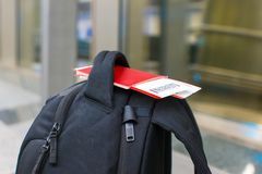 Closeup passports and boarding pass on backpack at Stock Photos