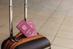 Closeup of passports on the luggage. Travel or emigration concept. Biometric passport of Moldova. Closeup of passports on the luggage. Travel or emigration royalty free stock photos
