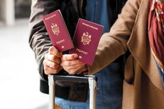 Closeup of passports on the luggage. Travel or emigration concept. Biometric passport of Moldova. Closeup of passports on the luggage. Travel or emigration royalty free stock image