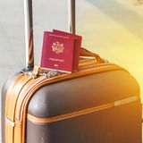 Closeup of passports on the luggage. Travel or emigration concept. Biometric passport of Moldova. Square photo. Closeup of passports on the luggage. Travel or royalty free stock images