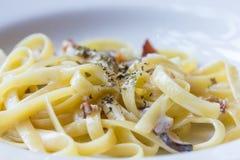 Closeup pasta with bacon carbonara sauce Royalty Free Stock Photos
