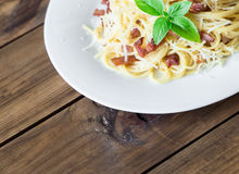Closeup of Pasta Carbonara. Spaghetti with bacon and parmesan cheese. Royalty Free Stock Photography
