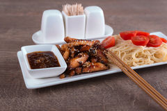 Closeup pasta with chicken and two chopsticks Stock Image