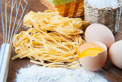 Closeup pasta, three eggs and flour Stock Photo