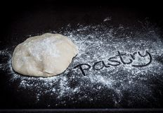 Closeup of pastry dough on baking board Stock Photography