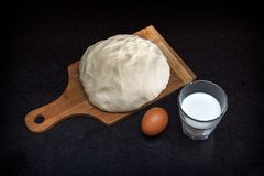 Closeup of pastry dough on baking board Stock Images
