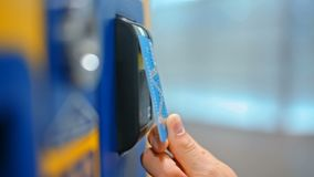 CloseUp of Paying by a Credit Card using PayPass Reader on a Vending Machine. CloseUp of Paying by a Credit Card using Paypass Reader on a Ticket Vending Machine stock footage