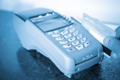 Closeup of payment machine. Payment on a credit card through the point of sale machines Stock Images