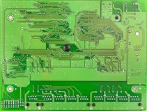 Closeup PCB green board top view. There are conductive paths, mounting holes Royalty Free Stock Photography