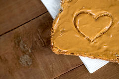 Closeup of peanut butter toast with heart shape on tissue Stock Photography