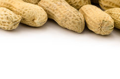 Closeup of Peanuts. Macro closeup of Peanuts,  on white background Stock Photos