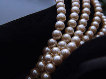 Closeup Pearls and Suede Stock Image