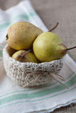 Closeup of pears in a crochet basket Stock Photo