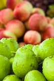 Closeup of pears with peaches in background Stock Image