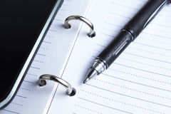 Pen, notebook and cell phone Royalty Free Stock Photos