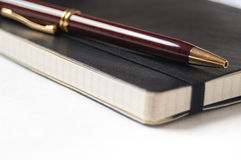 Closeup of a pen and notebook Royalty Free Stock Images