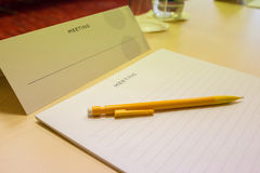 Closeup pen on table in empty corporate conference room Royalty Free Stock Photos