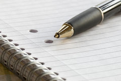 Closeup of a pencil on a writing pad Stock Image