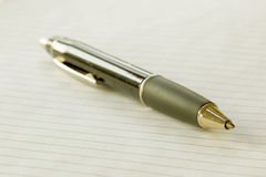 Closeup of a pencil on a writing pad royalty free stock photos