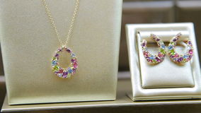 Closeup of pendant and earrings on display stock footage