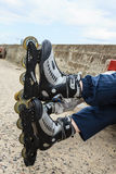 Closeup of people friends with roller skates. Royalty Free Stock Photos