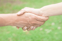 Closeup of people shaking hands Royalty Free Stock Images