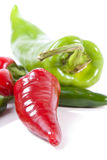 Closeup of peppers. Vertical color view of anaheim, red jalapeno and green serrano hot peppers with shallow depth of field Stock Photos