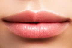 Closeup perfect natural lip makeup. Beautiful plump full lips on female face. Clean skin, fresh make-up. Spa tender lips. Close-up perfect natural lip makeup royalty free stock image