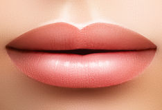 Closeup perfect natural lip makeup. Beautiful plump full lips on female face. Clean skin, fresh make-up. Spa tender lips. Close-up perfect natural lip makeup royalty free stock photography