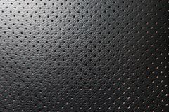 Closeup perforated artificial black leather background texture.  Stock Image