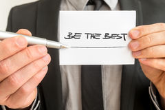 Closeup of personal therapist showing a white card with a Be the Royalty Free Stock Photos
