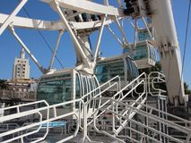 White Solid Ferris Wheel Cabins Closeup Perspective. Closeup Perspective on White Solid Ferris Wheel Cabins stock image