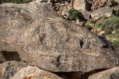 Closeup petroglyphs etched in rocks. Closeup of petroglyphs symbols etched in rocks in Arizona on a hot sunny day Stock Photos