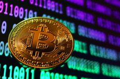 Closeup of phisical bitcoin over abstract background. Background and concept image Royalty Free Stock Images