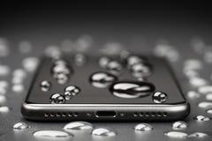 Closeup phone be waterproof shot on black background. Close-up phone be waterproof shot on black background Royalty Free Stock Image