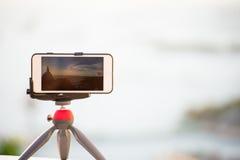 Closeup phone shooting time lab. Sunrise view Stock Photos