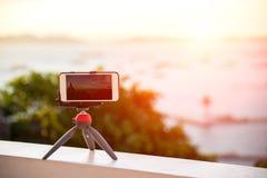 Closeup phone shooting time laps sunrise. View Royalty Free Stock Photo