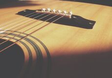 Closeup Photo of Acoustic Guitar Body and String Royalty Free Stock Image