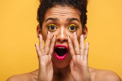 Closeup photo of african american woman emotionally shouting or Royalty Free Stock Images